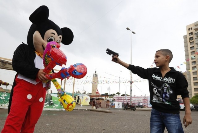 A Syrian refugee vs. Mickey Mouse
