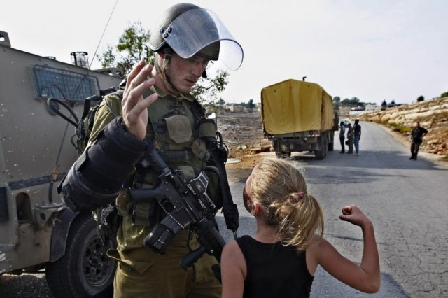 A little Palestinian girl vs an Israeli soldier