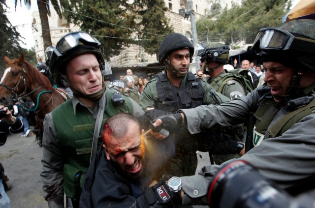 A man being pepper-sprayed directly in the face