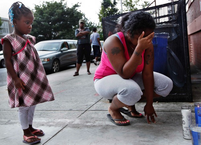 A woman grieving for her brother and cousin in Brooklyn - New York