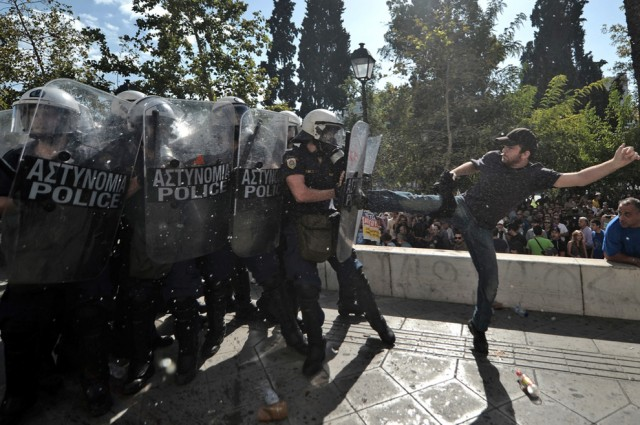 Kicking riot police in Greece