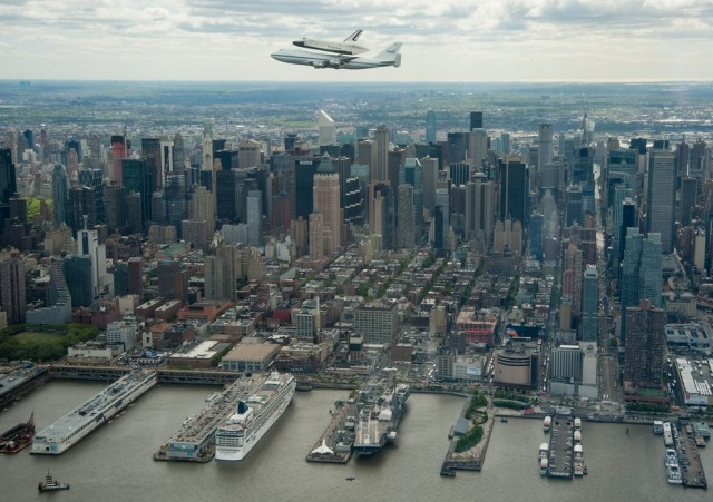 The Space Shuttle Enterprise flying above New York City