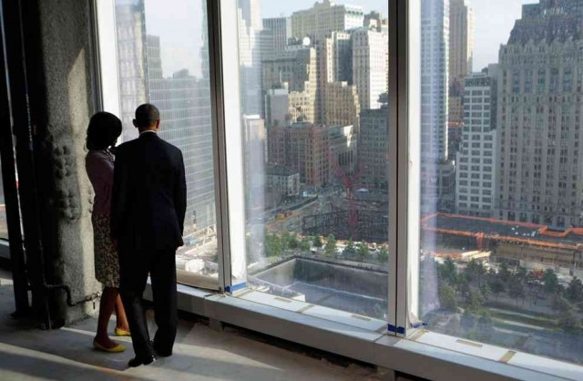 The president and First Lady looking down onto the 9-11 memorial
