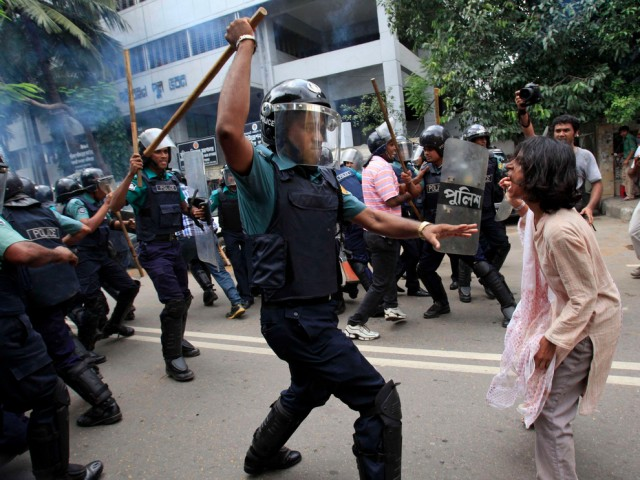 The protester in Bangladesh about to be smashed with a baton